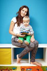 Mom and boy in children room