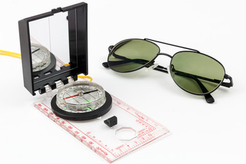 Compass and pilot sunglasses with white background