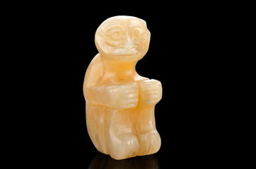 Carved aragonite sitting monkey