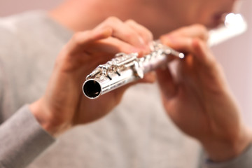 Fragment of flute in the hands of a musician