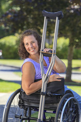 Woman with Spina Bifida in wheelchair with crutches