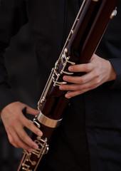 Human hand playing the bassoon