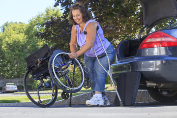 Woman with Spina Bifida putting wheelchair together