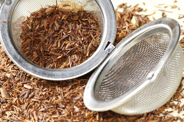 rooibos tea close up with tea strainer