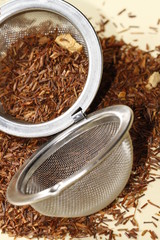 rooibos tea with orange zest and strainer