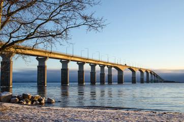 Winter beach by the bridge