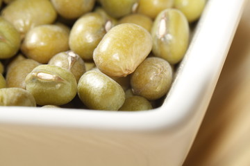 close up of mung beans in white bowl