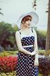 Woman in hat retro portrait