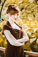 Beautiful redhead girl the park
