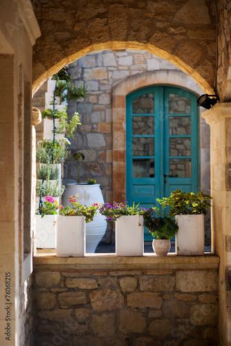 Greek flowerpots with flowers