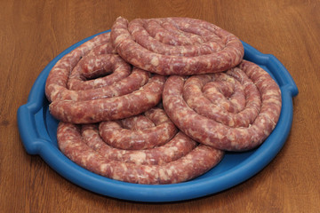 Four rings of sausage on the blue tray