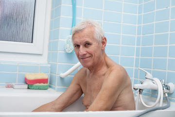 Happy senior man in bath