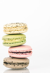 Stack of four macaron cookies with white background