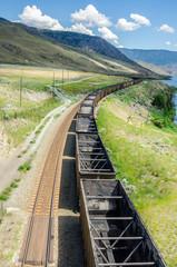 Empty Cargo Train on a Mountainous Region