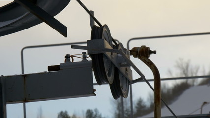 The rollers and pulleys of the mechanical ski lift