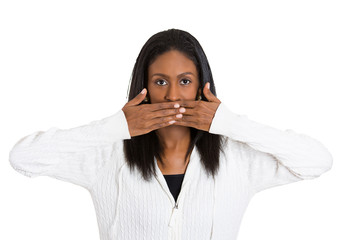middle aged woman covering closed mouth speak no evil