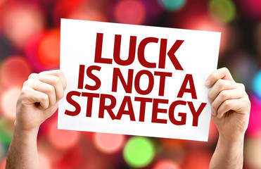Luck is Not a Strategy card with colorful background