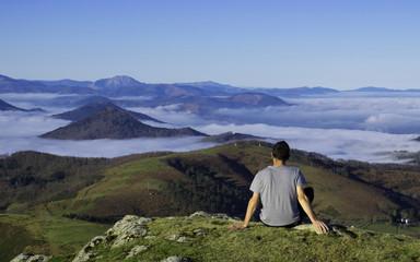 Man enjoying the landscape, Basque country.