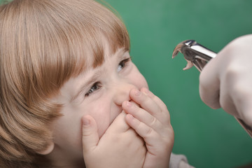 Small child and dental instrument