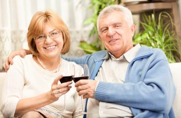 Happy senior couple toasting their anniversary