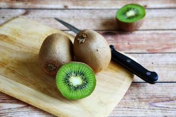 fresh kiwi on cutting board