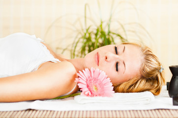 Young woman relaxing at the spa center