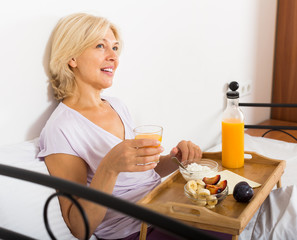 mature woman enjoying  breakfast