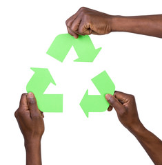 Hand holding green recycling arrows symbol
