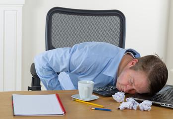 Mature man falling asleep at work
