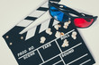 Clapboard with 3d glasses and popcorn.