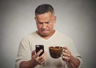 worried angry frustrated man reading bad news sms on smartphone