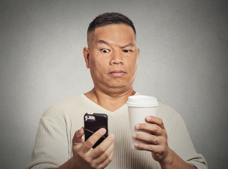 worried surprised man reading bad news sms on smartphone