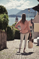 Girl on the cobbled street of Menaggio town. Lake Como, Italy --