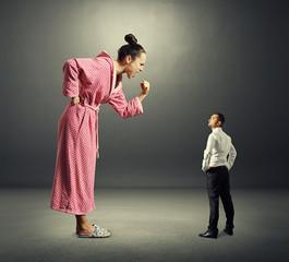 small serious man and big angry woman