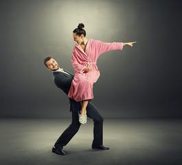 smiley man holding screming woman