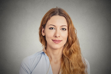 Happy smiling young woman isolated on grey background