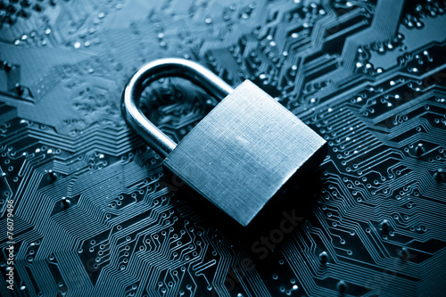Leinwandbild Motiv security lock on computer circuit board - computer security
