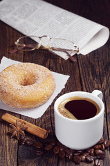 Coffee, donut, newspaper and glasses