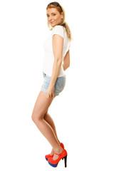 Summer fashion. Pretty sexy girl in denim shorts