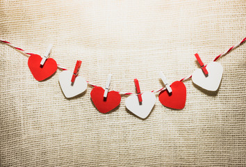 Love Valentine's hearts natural cord and red clips hanging