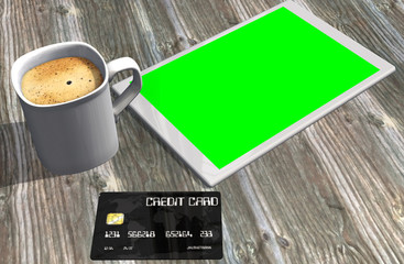 green screen tablet PC credit card and cup of coffee