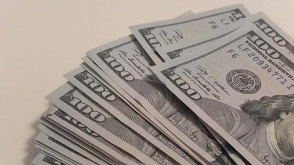 rich man grabs one hundred dollar bills