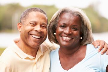 Portrait Of Happy Senior Couple In Garden