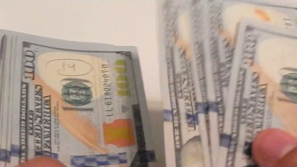 Close-up of a hands counting new one hundred dollar bills