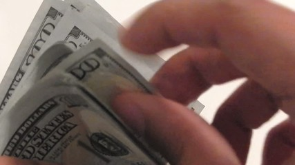 counting a lot of one hundred dollar bills