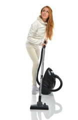Young happy woman cleaning home floor with vacuum cleaner