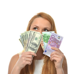 Happy young woman holding up cash money dollars and euros