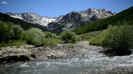 Alpine scene with stream in the Rocky Mountains, Western America