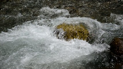 Clean, pure running water in stream in the mountains