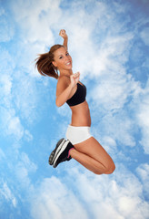 Attractive girl with fitness clothing jumping